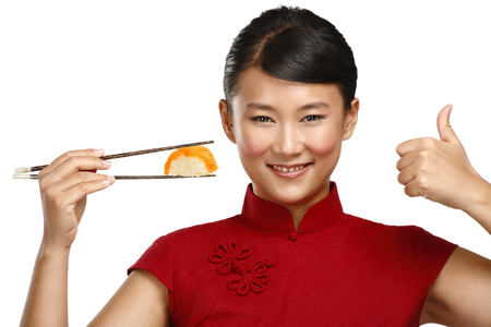 Chinese woman showing asian food using chopstick on white photo