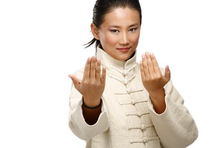 fu: Beautiful asian woman make kung fu gesture  on white Stock Photo