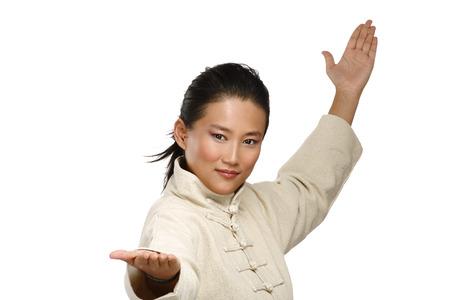 Beautiful asian woman make kung fu gesture  on white photo
