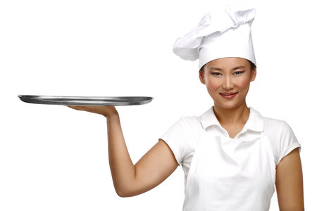 Happy smiling asian chinese woman chef at work on white photo