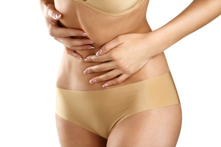 intestinal problems: Closeup of a young woman with bellyache on white