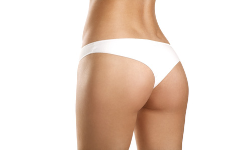 woman buttocks: Closeup of a beautiful woman showing perfect buttocks on white Stock Photo