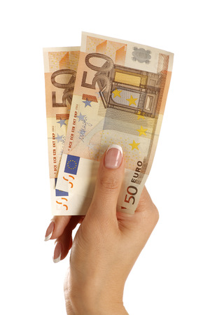 One hundred euro in a beautiful female hand on white photo