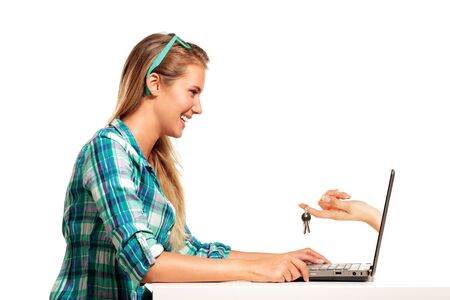 Young Woman Sitting at the desk  shopping Online on white photo