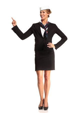 flight attendant: Charming flight stewardess showing various gesture  on white