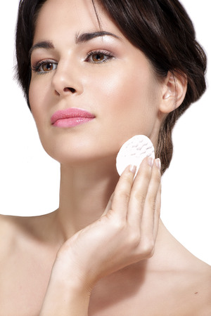 remover: young beautiful woman remove makeup from perfect skin on white