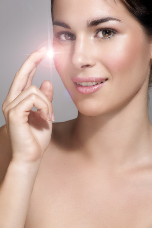 beautiful model showing her perfect skin light effect neutral background Stock Photo