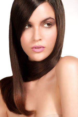 smooth hair: Beauty model showing perfect skin and long healthy brown hair on white Stock Photo