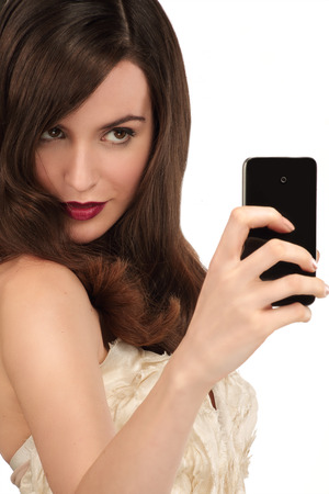 taking photograph: Beautiful woman taking a selfie with  smartphone on white Stock Photo
