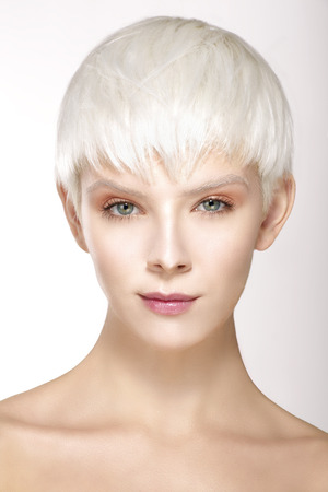 Beauty model blonde short hair showing perfect skin  on white 스톡 콘텐츠
