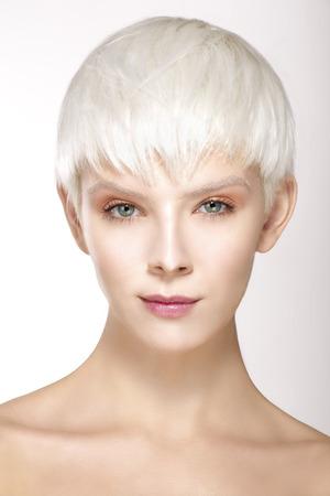 Beauty model blonde short hair showing perfect skin  on white Standard-Bild