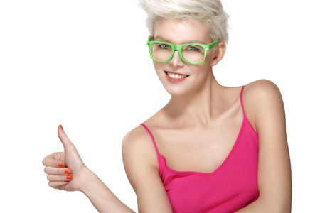glasses model: pretty young blond model wearing cool eyeglasses on white Stock Photo
