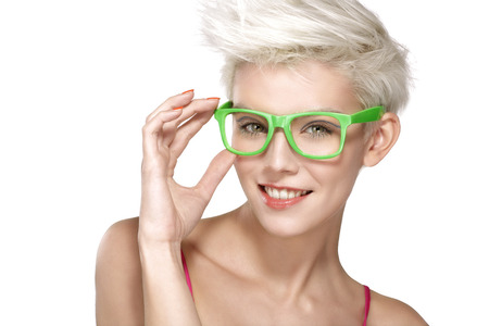 girl glasses: pretty young blond model wearing cool eyeglasses on white Stock Photo
