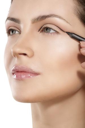 model making eyeliner on eye  closeup Archivio Fotografico