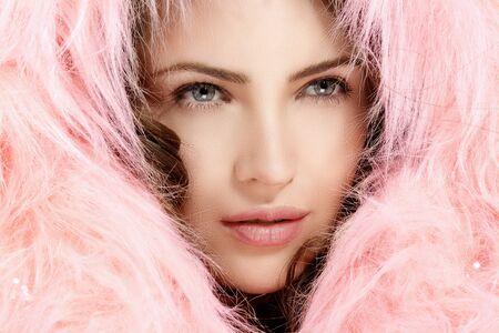 fur hood: Beautiful model protect her head with a pink warm fur hood