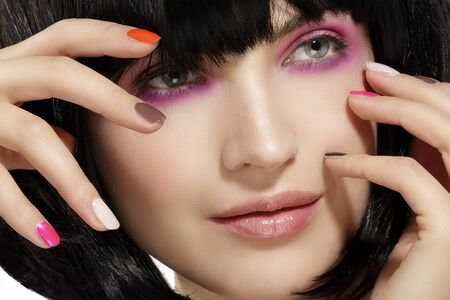 pink lips: Beauty model hairstyled  and pink eye shadows makeup  closeup on white