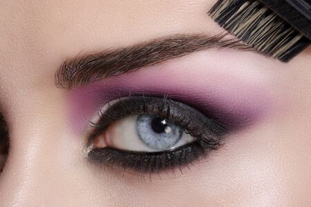 girl shadow: Close up on eyes , making colorful eyeshadows and eyeliner tutorial Stock Photo