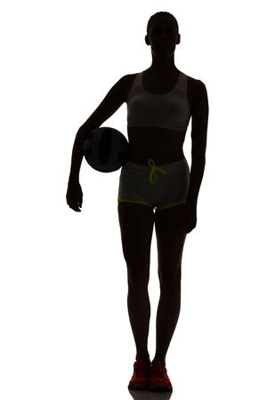 beach volley: oone woman beach volley ball player silhouette in studio silhouette isolated on white background