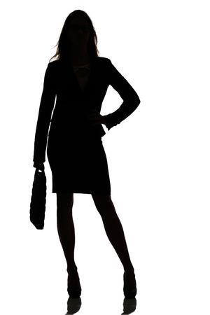 plan éloigné: silhouette d'une femme d'affaires studio de rétroéclairage occupé sur blanc