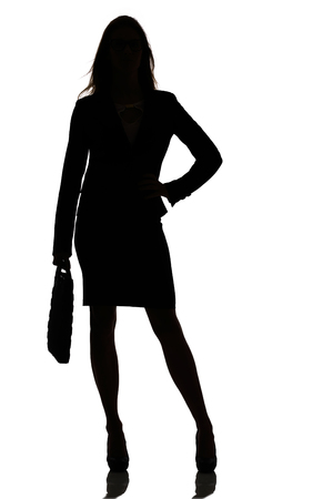 out of business: silhouette of a busy business woman backlight studio on white