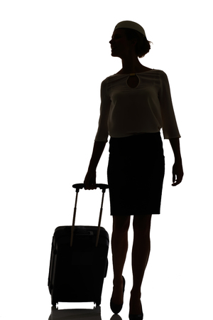 business woman standing: hostess business class travel silhouette studio shot on white