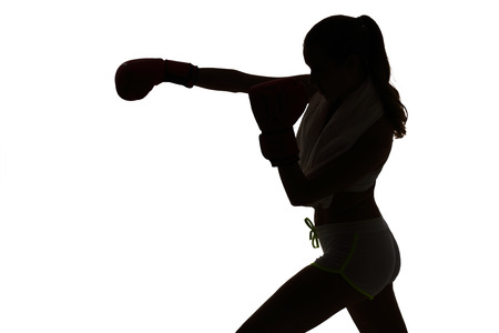 one caucasian woman boxing exercising in silhouette studio isolated on white background Standard-Bild