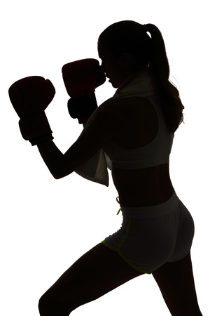 one female: one caucasian woman boxing exercising in silhouette studio isolated on white background Stock Photo