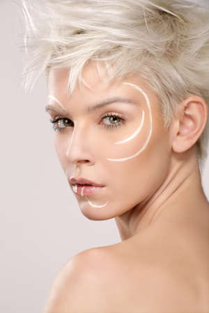 the trendy: beautiful blond model wearing elegant artistic makeup white background