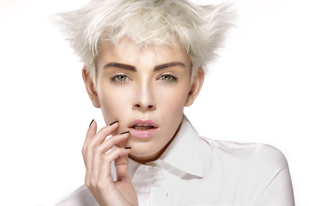 cabello corto: Beauty model blonde short hair showing perfect skin  on white Foto de archivo