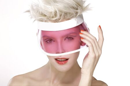 visor: beauty shot blond perfect young model wear pink visor  on white Stock Photo