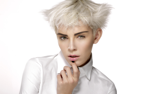 short: Beauty model blonde short hair showing perfect skin  on white Stock Photo