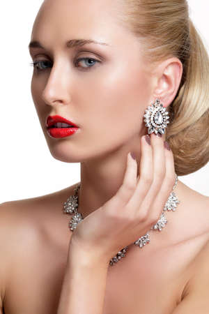 silver jewelry: Pretty woman  and beautiful gold an silver jewelry on white