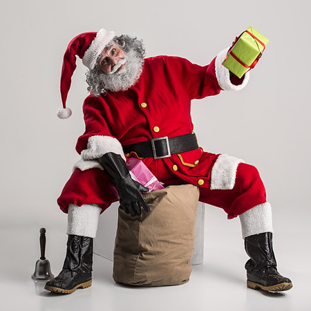 authentic: cheerful funny traditional santa claus with bag Stock Photo