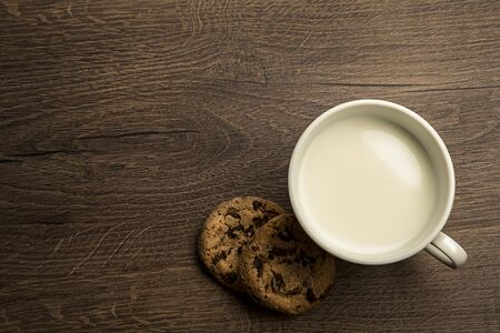 breakfast cup: delicious hot cup of milk , breakfast  on old wooden table Stock Photo