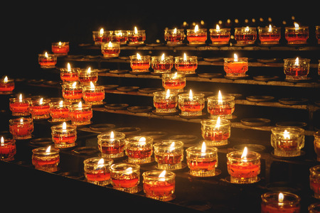 Rows of votive candles in a Catholic church. Landscape format.