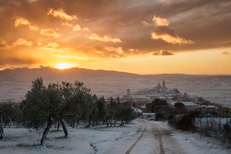 A view of Trevi in Umbria (Italy) at sunset with snow. Landscape format.