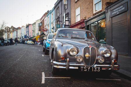 Vintage Jaguar parked in Portobello Road in Notting Hill. London (UK), July 2017. Landscape format.