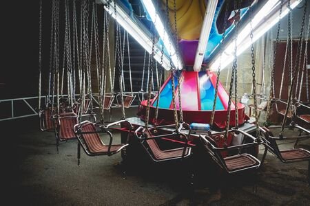 Empty children carousel in a local funfair. Landscape format.
