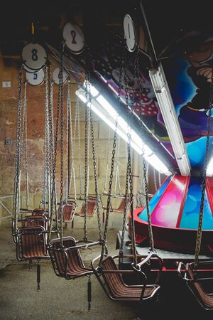 Empty children carousel in a local funfair. Portrait format.
