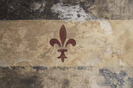 A fleur de lis painted on a column in the medieval village of Turin (Italy) Stock Photo