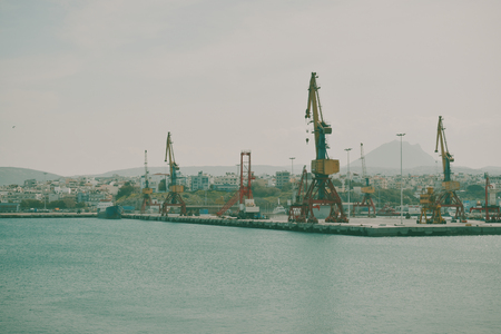 Boats and cranes  in the sea port. on the background containers