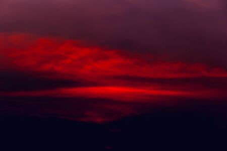 The red-orange sky caused by the light at sunset is the art of nature, abstract background
