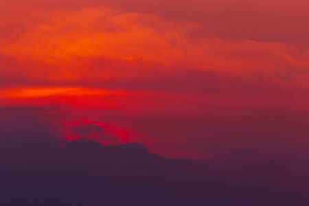 The landscape of the red sky Colorful oranges in the twilight with clouds like mountains, abstract backgrounds 스톡 콘텐츠