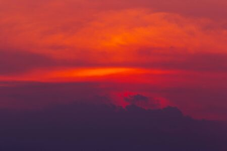 The colorful sky of red Orange and with clouds like mountains are a bright background from nature