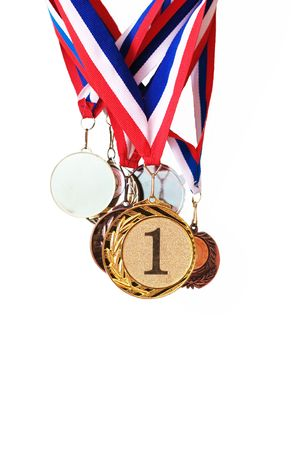 Collection of sports medals on a wall on a white background