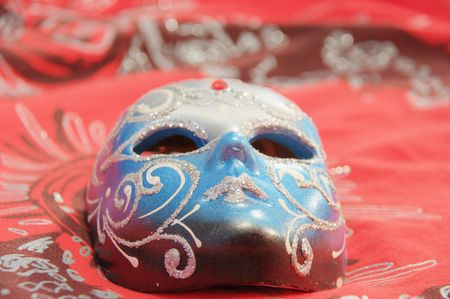 mask on the table in red calor photo