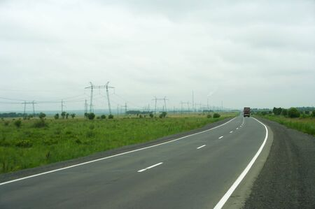 Road in the country against  electricity support Stock Photo - 7408687