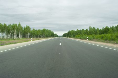 Direct road in the country leaving afar Stock Photo - 7408703