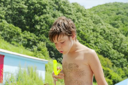 hot boy: The boy blows in a tube for swimming under water