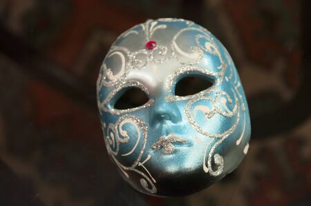 The Venetian mask on a transparent table photo
